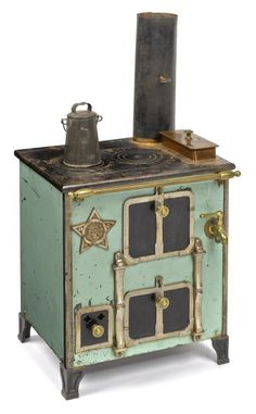 Cast iron, nickel, copper, and enameled toy stove, 15 1/4'' h., 13'' w., together with a tin pot.