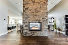 Suitable double sided fireplace for sale to inspire you Home Fireplace, Fireplace Remodel, Living Room With Fireplace, Fireplace Surrounds, Fireplace Design, Custom Home Builders, Custom Homes, Estilo Joanna Gaines, See Through Fireplace