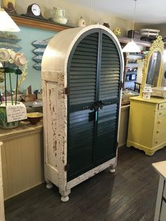 One of a kind cabinet created from turn of the century reclaimed architectural pieces to create this beautiful piece made to last for generations. Handmade Cabinets, Woodworking As A Hobby, Modern Rustic, Shutters, Wardrobes, Locker Storage, Architecture, Building, House