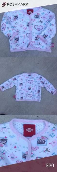 Oilily Infant Girls Top White background with pink trim, framed kitty's with flowers, flowers, hearts,birds with a letter, and the brand name OILILY on the fabric. 4 snaps up the front, long sleeves. 100% Cotton. New condition. Oilily Shirts & Tops