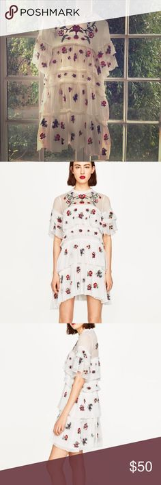 NWOT white embroidered flower ZARA dress. never worn before, beautiful summer dress. Mini dress with floral embroidery, round neck and short sleeves, frill on the body, lining, back teardrop opening. Zara Dresses Mini