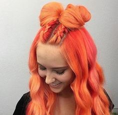 Braided and big bow ribbon hairstyle for pastel neon orange in soft waves | Orange hair color idea