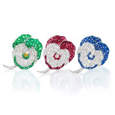 Two Platinum, Diamond, Ruby and Sapphire Pansy Clip-Brooches by Oscar Heyman Bros., and a Fancy Colored Yellow Diamond, Diamond and Emerald Pansy Brooch by Udall & Ballou