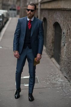 Shop this look on Lookastic: http://lookastic.com/men/looks/sunglasses-dress-shirt-tie-waistcoat-suit-derby-shoes/7673 — Black Sunglasses — Charcoal Dress Shirt — Red Polka Dot Tie — Black Waistcoat — Navy Suit — Black Leather Derby Shoes