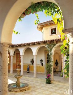 A stone fountain punctuates the arcaded atrium, which is paved with handmade cement tiles.
