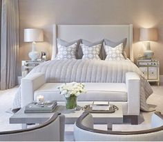 bedding with lavish quilted satin throws, delicate cream pearls