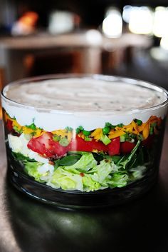 Ree Drummond's version of 7-Layer Salad...I love this, and don't make it often enough. U can pick ur fav veggies/salad things..olives, bell or sweet peppers, cucumber, chicken or ham...and recipe says to cover and let sit overnight (dressing seals salad). ENJOY!