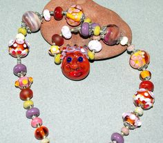 Face necklace brown necklace funny glass by DewLampworkArt on Etsy