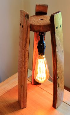Scotch Whisky barrel stave edison table lamp, with or without a hanging edison bulb : Scotch Whisky barrel lamp, with or without a hanging edison bulb by BeeSpokeBarrels on Etsy Edison Lampe, Led Lampe, Rustic Lamps, Rustic Lighting, Bourbon Barrel Furniture, Wine Barrel Crafts, Barrel Projects, Barrel Table, Candle Lamp