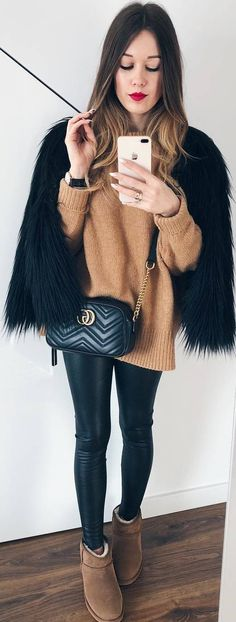 #winter #outfits brown sweater, black faux fur, leather leggings, brown boots