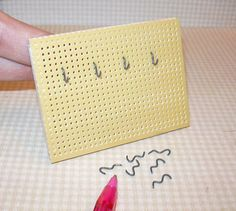Miniature workshop board with hooks (image only) | Source: Unknown