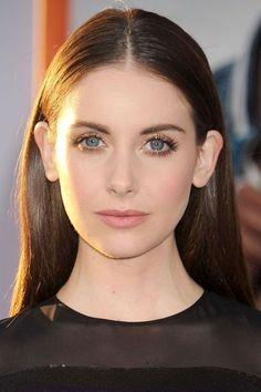 We can't stop staring at the Mad Men actress's flawless, rosy-pink complexion and sparkling gold eyes: