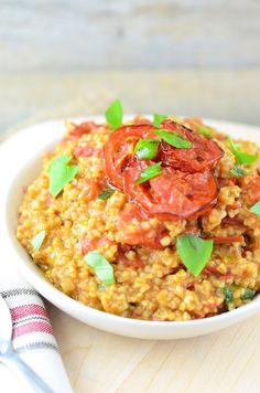Roasted Tomato Basil Oatmeal (vegan savory oatmeal)  Ingredients 1½ cups Steel Cut Oats 3 cups Water 6 Roma Tomatoes (sliced) 2 tablespoons Extra Virgin Olive Oil (plus additional for drizzling if desired) ¼ cup Fresh Basil (roughly chopped) ⅛ teaspoon Garlic Powder Salt and pepper (to taste)