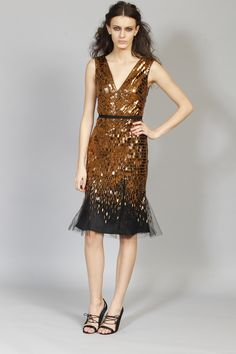 Carolina Herrera 2012--ignore the model and her grim expression.  This a gorgeous bronze and black cocktail dress.  If I could wear this I would be thrilled!!!