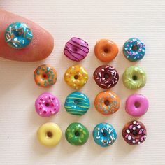 No tutorial, just a picture. They look like Cherrios painted with nail polish*