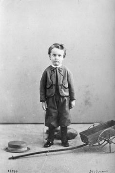 A boy and his wagon, 1860s