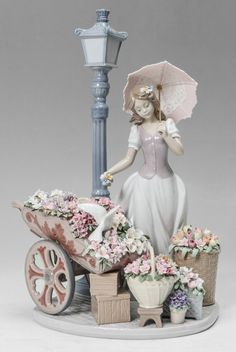 LLADRO PORCELAIN FIGURINE: ''FLOWERS FOR EVERYONE'' #6809, Miguel Angel Santaeulalia sculptor, issued 2002, approx. 15'' x 10.25'' x 8.5'' - Sold $950