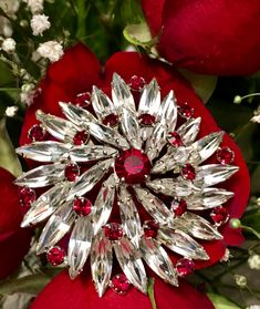 Sherman brooch set with Siam and Clear Swarovski crystals , rhodium plated .