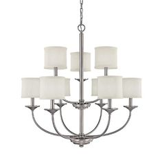 This 9-light chandelier has white decorative shades which soften the light emitted. Featuring a matte nickel finish, this fixture will compliment most decors