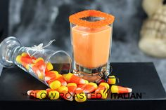 Candy Corn Cocktail Shooters - candy corn infused whipped cream vodka, rum, and french vanilla creamer