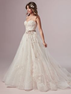 0c1785527f0 This lovely allover lace wedding dress is accented with soft lace motifs  atop an A-