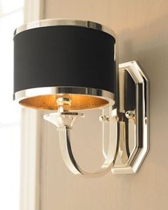 Modern wall sconce for hall and stairways.