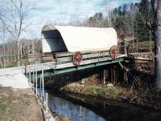 The Conestoga Wagon before the wood Smith Covered Bridge was built. Photo by Mark Comstock 12-2002, submitted by Mike MacCarter. Smith Covered Bridge, 34', 2009, 48-40-A #2, across Hurricane Creek SE of Hurricane, Curry Township, Putnam County, West Virginia. Teays Ln. WV34 S. 1.2 miles from jct with WV34A (Main St.) in Hurricane, E. on US60 2.9 miles to the bridge on the S. side of the road. (N38 24.587 W81 58.127) Photo by El Sayre 12-3-10.