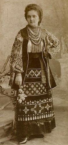 Girl from Lviv, Ukraine in regional folk dress and beads. 1880.