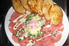 Fleming's TENDERLOIN CARPACCIO* with caper creole mustard sauce and red onion. YUM! Hard to believe I was a vegetarian for 7 years.