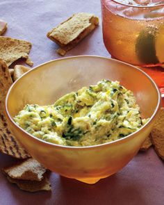 Creamy Zucchini and Ricotta Spread  Sauteed grated zucchini and garlic combine with ricotta cheese and lemon juice and zest to create this light and brightly flavored spread. Serve this party appetizer with pita chips.