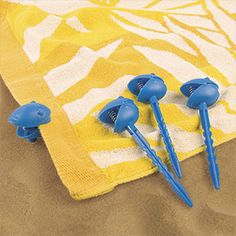 TOWEL CLIP STAKES. Bye-bye, bunched-up picnic blankets...so long, sandy, windblown towels! These clever beach towel stakes anchor your gear in place, for happier, easier picnics and beach outings. Plastic. Assorted colours.