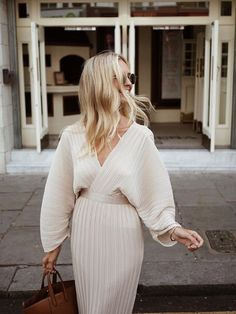 Long sleeved cream dress for spring.