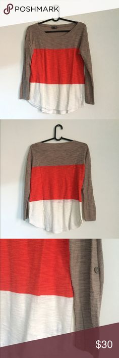 """EXPRESS Color Block Lightweight Sweater Perfect for fall. Tan, bright orange and white color block sweater. So simple to dress up or down. Some pilling, but in excellent used condition. One single tan button on outside of each sleeve. Cotton/Rayon blend. Nicely breathable. You can smash some serious pumpkins lattes in this. That's still a thing, right?  Length: 21-24.5"""" Bust: 36"""" Express Sweaters Crew & Scoop Necks"""