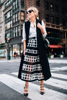 street style - street chic style - fall outfits - casual outfits - fall / winter - business casual - office wear - party outfits - work outfits - black sunglasses + black stilettos + black long vest + white shirt + black and white mesh panel midi skirt