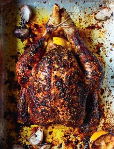 Roast chicken with pomegranate and za'atar glaze recipe from The Saffron Tales by Yasmin Khan   Cooked