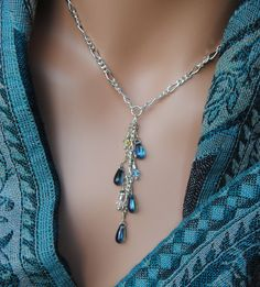 Swarovski Crystal and Glass Teardrop Bead Waterfall Dangle Necklace WOW. $26.95, via Etsy.