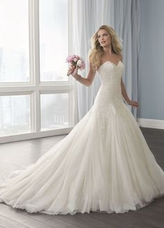 Featured Dress: Christina Wu; Wedding dress idea.