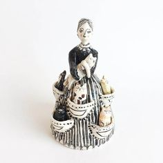 Crazy Cat Lady with cats in her dress pockets ceramic figurine