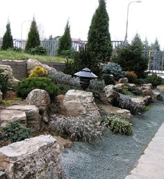 so beautiful ... gotta have some stone work woven into the landscaping.