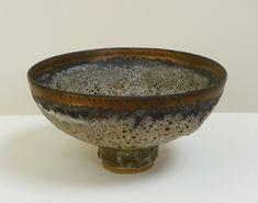 Lucie Rie - 1986, stoneware, grey bubbly glaze, bronze band, diam. 21cm