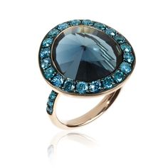 Annoushka Dusty Diamonds ring with a 10.50ct London Blue topaz surrounded by blue diamond pavé on a rose gold band (£2,600).