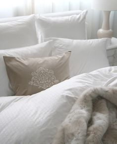 Perfect white and beige bedding with ivory faux fur throw.  Au Lit Fine Linens #white #bedding #interiordesign @aulitfinelinens via @lauzonflooring