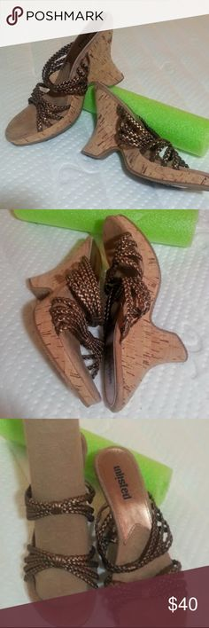 """Braided bronze strap cork wedge sandals size 8 EUC Unlisted - A Kenneth Cole Production  Bronze faux leather braided straps, cork platform. Worn once. In perfect condition (except for odd mark on top front, shown in pic 7, created from being up against each other in box. They had this brand new when purchased)  I cannot find a size marked on them, bur I've been buying 8 for 20 years, so I'm 99% sure they are size 8.  They measure  10"""" heel to toe, in a straight line, I did not follow curve…"""