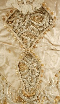 Wedding dress Date: 1890s Culture: American Medium: silk, cotton, beads
