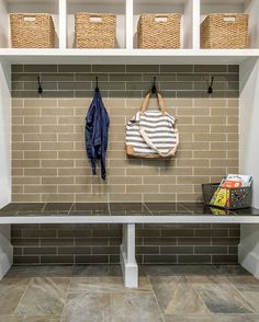 Adding a subway tile accent wall brings durability to your mudroom. A tiled wall is also easy to clean. Flooring and bench are also tiled for extra durability and low-maintenance.