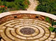 Labyrinth/spiral patio designs.  Love this one.