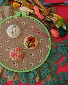 A bit of embroidery turns simple fabric-covered buttons into mini works of art.