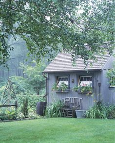 quaint garden shed in a lush backyard garden  Just makes me smile-Think Summer!