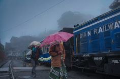 Just as we got down at Ghoom railway station which is in Darjeeling, I spotted which lady who was on her way to her work as well as a guy carrying some grains needed for his house against the backdrop of the toy train which made for interesting frame as it was raining early morning.