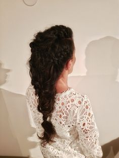 Bohemian multibraided hairstyle.